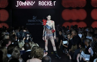 A model walks down the runway at the Swarovski Runway Rocks fashion show